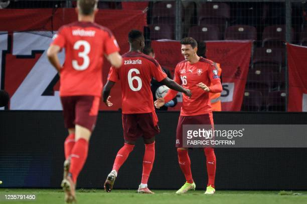 Switzerland's midfielder Christian Fassnacht celebrates scoring his team's second goal during the FIFA World Cup 2022 Group C qualification football...