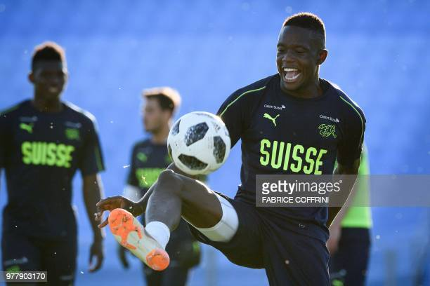 Switzerland's midfielder Denis Zakaria controls the ball during a training session at Torpedo Stadium in Tolyatti also known as Togliatti on June 18...