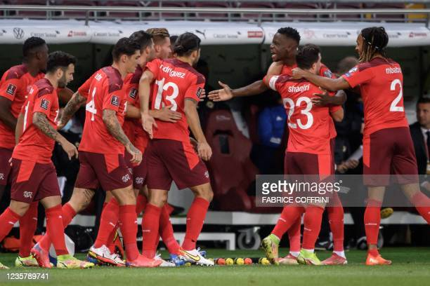 Switzerland's midfielder Denis Zakaria reacts with teammates after scoring a goal that was later invalidated by VAR during the FIFA World Cup 2022...