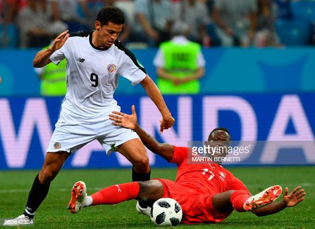 TOPSHOT Switzerland's midfielder Denis Zakaria vies vies for the ball with Costa Rica's forward Daniel Colindres Solera during the Russia 2018 World...