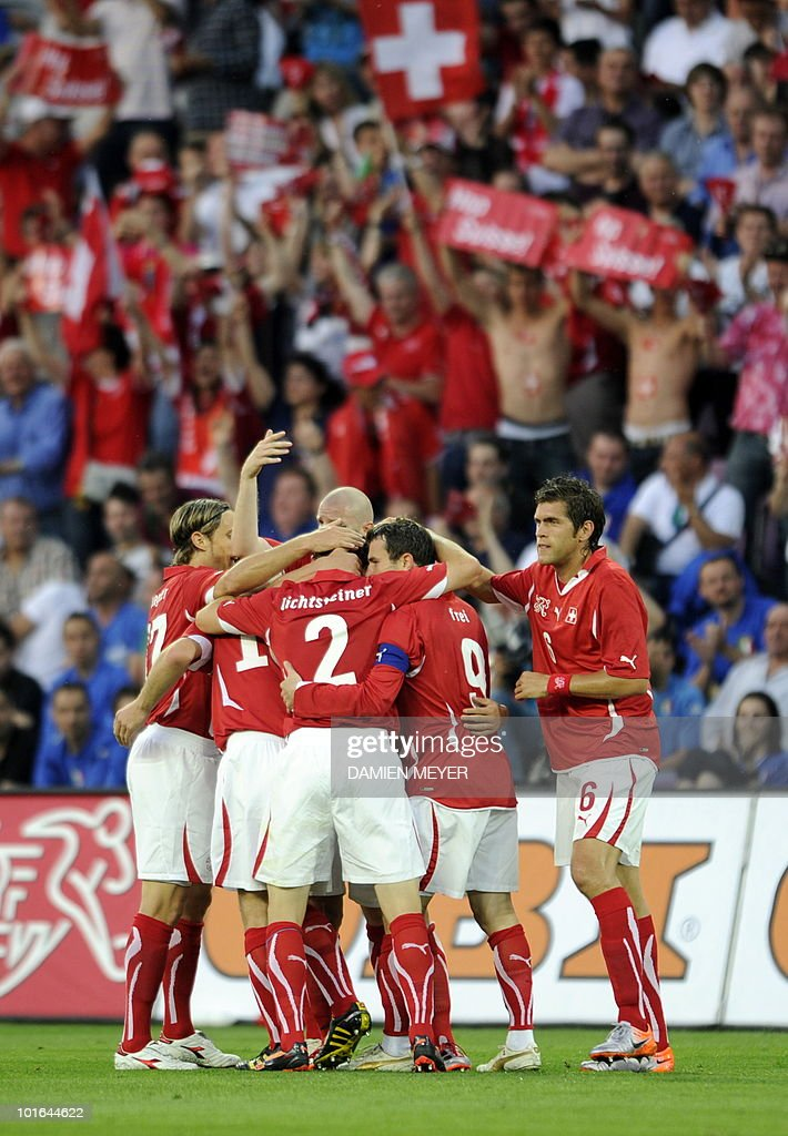 Switzerland's midfielder Gokhan Inler is congratulated by teammates after scoring against Italy during the WC2010 friendly football match Switzerland vs Italy at Geneva's stadium on June 5, 2010 ahead of the FIFA 2010 World Cup held in South Africa.