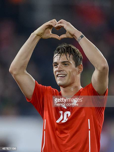 Switzerland's midfielder Granit Xhaka after he scored the team's second goal during the Euro 2016 qualifying football match between Switzerland and...