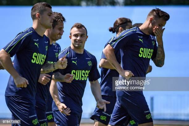 Switzerland's midfielder Granit Xhaka and forwards Mario Gavranovic Xherdan Shaqiri and Haris Seferovic take part in a training session at Torpedo...