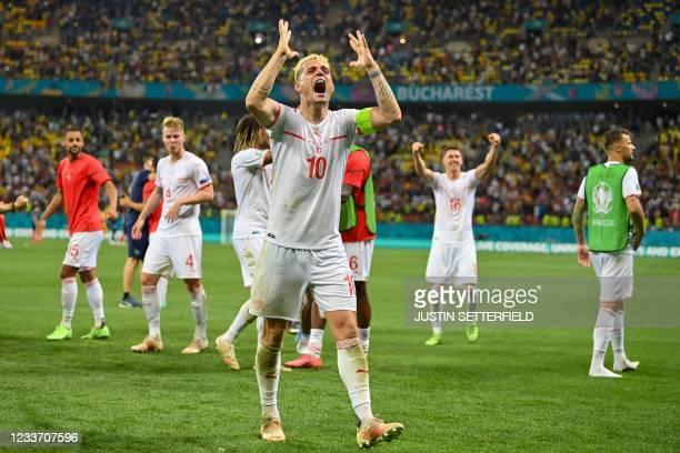 Switzerland's midfielder Granit Xhaka celebrates after winning the UEFA EURO 2020 round of 16 football match between France and Switzerland at the...