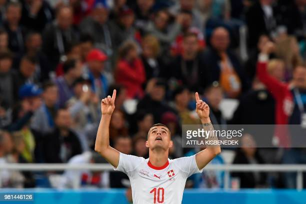 TOPSHOT Switzerland's midfielder Granit Xhaka celebrates scoring during their Russia 2018 World Cup Group E football match between Serbia and...