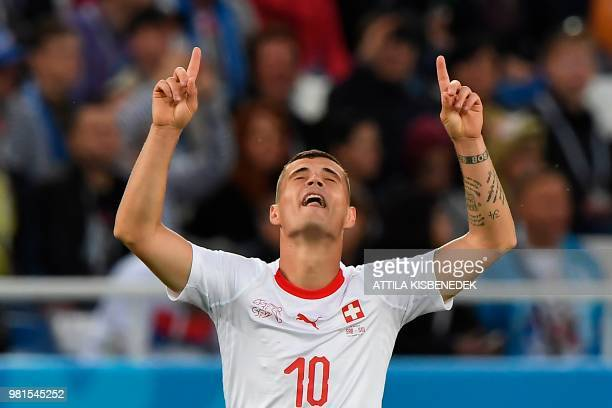 Switzerland's midfielder Granit Xhaka celebrates scoring during their Russia 2018 World Cup Group E football match between Serbia and Switzerland at...