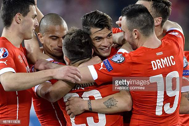 Switzerland's midfielder Granit Xhaka celebrates with teammates after scoring his team's second goal during the Euro 2016 qualifying group E football...
