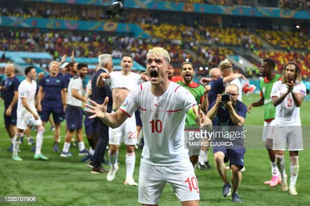 Switzerland's midfielder Granit Xhaka celebrates with the fans after their win in the UEFA EURO 2020 round of 16 football match between France and...