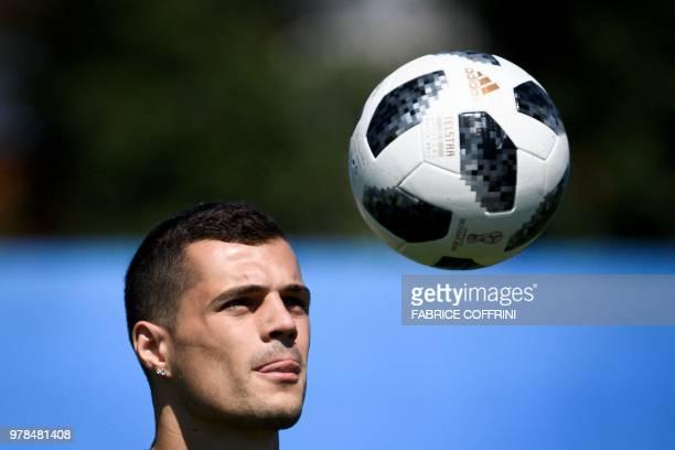 Switzerland's midfielder Granit Xhaka controls the ball during a training session at Torpedo Stadium in Tolyatti also known as Togliatti on June 19...