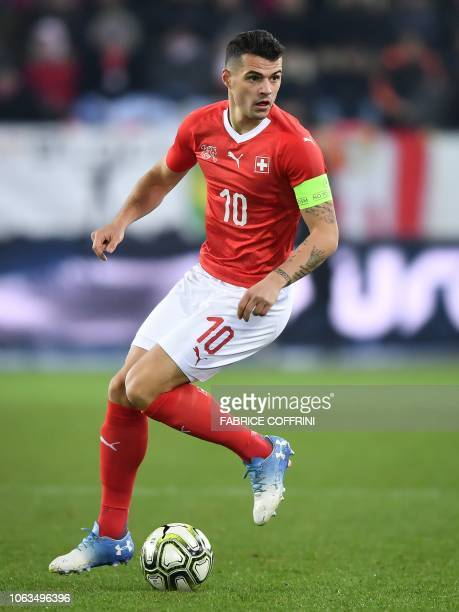 Switzerland's midfielder Granit Xhaka controls the ball during the UEFA Nations League league A group 2 football match between Switzerland and...