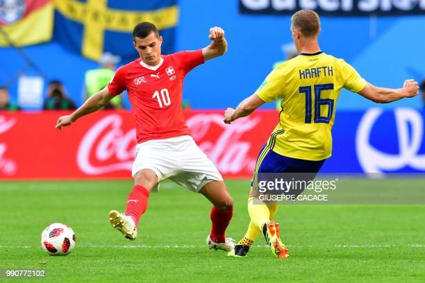 Switzerland's midfielder Granit Xhaka fights for the ball with Sweden's defender Emil Krafth during the Russia 2018 World Cup round of 16 football...