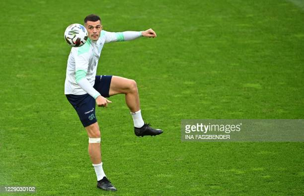Switzerland's midfielder Granit Xhaka kicks a ball during a training session on the eve of the UEFA Nations League football match Germany v...