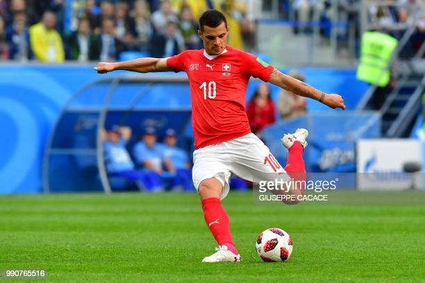 Switzerland's midfielder Granit Xhaka kicks the ball during the Russia 2018 World Cup round of 16 football match between Sweden and Switzerland at...