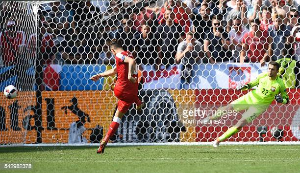 TOPSHOT Switzerland's midfielder Granit Xhaka misses his attempt during the penalty shootout during the Euro 2016 round of sixteen football match...