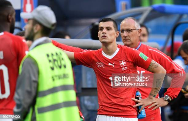 Switzerland's midfielder Granit Xhaka reacts at the end of the Russia 2018 World Cup round of 16 football match between Sweden and Switzerland at the...