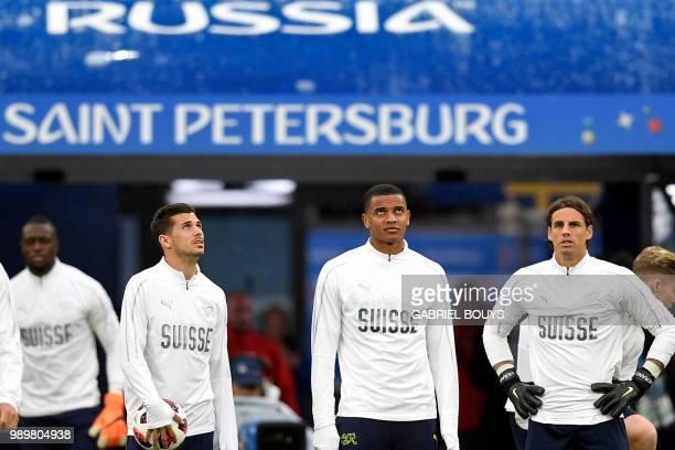 Switzerland's midfielder Remo Freuler Switzerland's defender Manuel Akanji and Switzerland's goalkeeper Yann Sommer stand sidebyside during a...