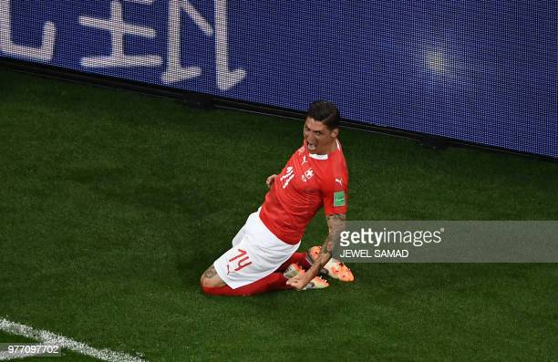 TOPSHOT Switzerland's midfielder Steven Zuber celebrates after scoring during the Russia 2018 World Cup Group E football match between Brazil and...