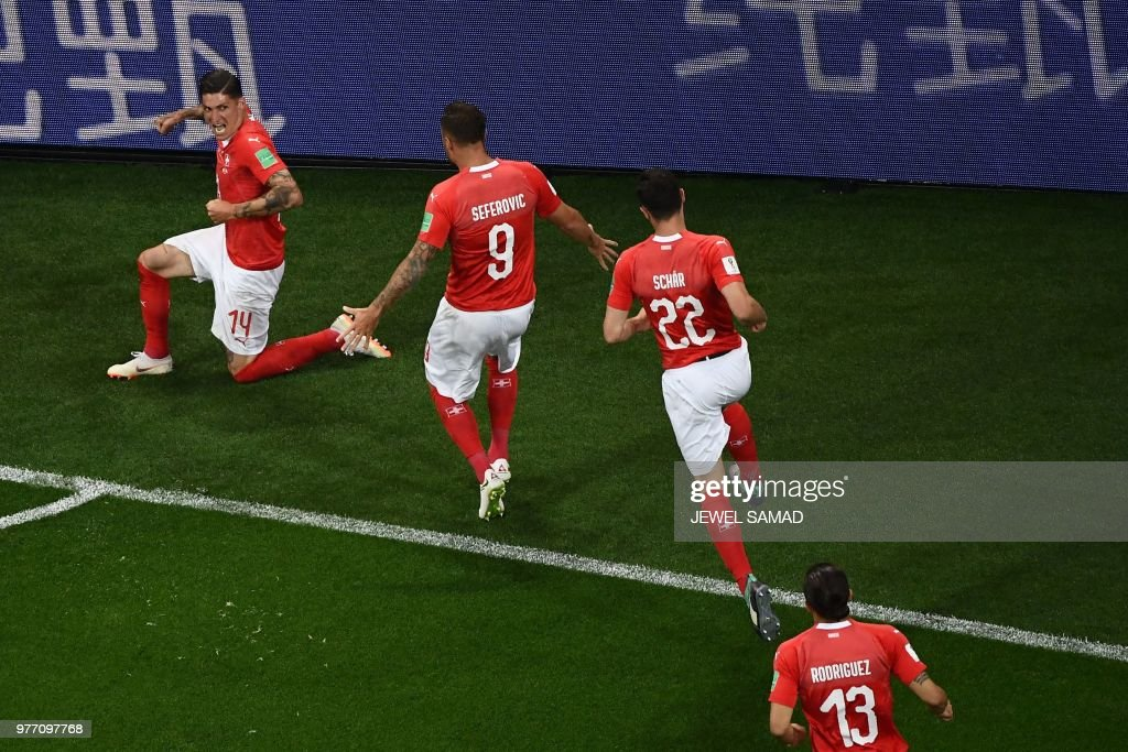 Switzerland's midfielder Steven Zuber (L) celebrates with teammates after scoring during the Russia 2018 World Cup Group E football match between Brazil and Switzerland at the Rostov Arena in Rostov-On-Don on June 17, 2018. (Photo by Jewel SAMAD / AFP) / RESTRICTED