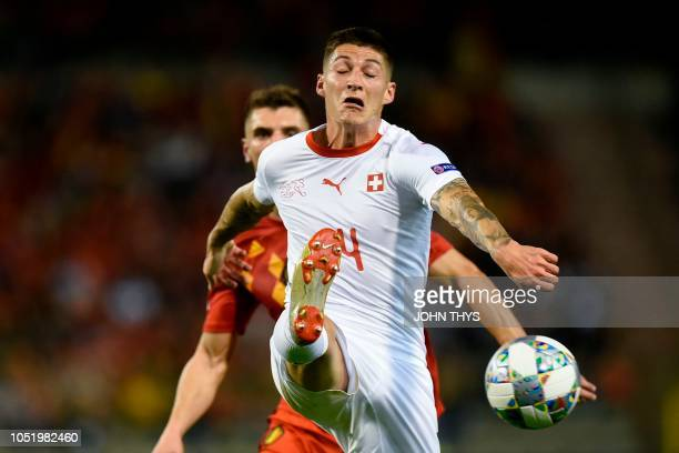 Switzerland's midfielder Steven Zuber fights for the ball during the UEFA Nations League football match between Belgium and Switzerland at the King...