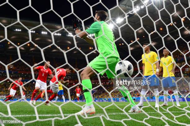 TOPSHOT Switzerland's midfielder Steven Zuber scores a goal past Brazil's goalkeeper Alisson during the Russia 2018 World Cup Group E football match...