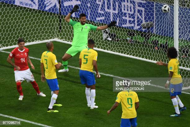 TOPSHOT Switzerland's midfielder Steven Zuber scores against Brazil's goalkeeper Alisson during the Russia 2018 World Cup Group E football match...