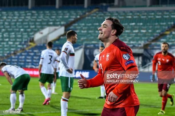 Switzerland's midfielder Xherdan Shaqiri celebrates after scoring a goal during the FIFA World Cup Qatar 2022 Group C qualification football match...