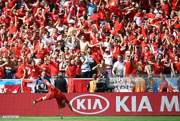TOPSHOT Switzerland's midfielder Xherdan Shaqiri celebrates after scoring his team's equaliser during the Euro 2016 round of sixteen football match...