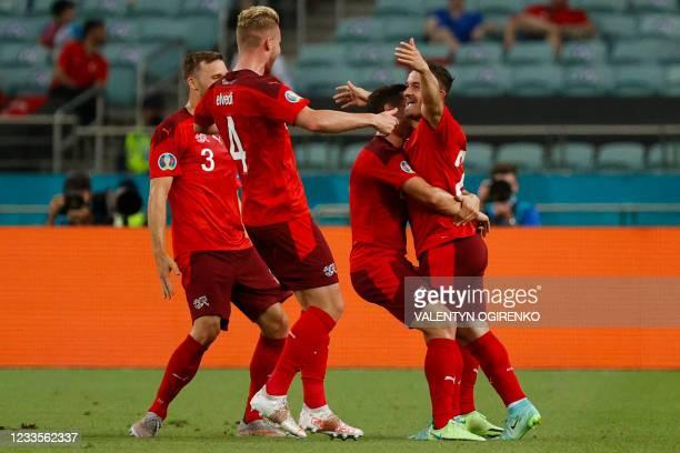 Switzerland's midfielder Xherdan Shaqiri celebrates scoring his team's second goal with his teamates during the UEFA EURO 2020 Group A football match...