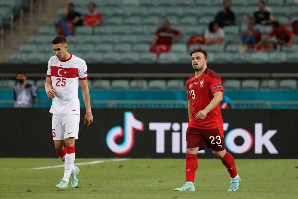 Switzerland's midfielder Xherdan Shaqiri celebrates scoring his team's second goal during the UEFA EURO 2020 Group A football match between...