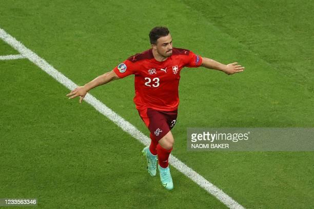 Switzerland's midfielder Xherdan Shaqiri celebrates scoring his team's third goal during the UEFA EURO 2020 Group A football match between...