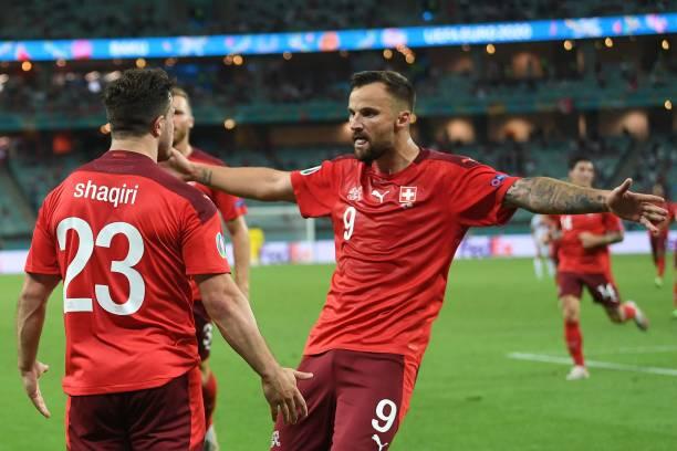 Switzerland's midfielder Xherdan Shaqiri celebrates scoring his team's third goal with his teammates during the UEFA EURO 2020 Group A football match...