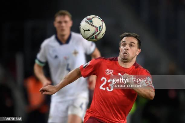 Switzerland's midfielder Xherdan Shaqiri eyes the ball during FIFA World Cup Qatar 2022 qualification football match between Switzerland and Northern...