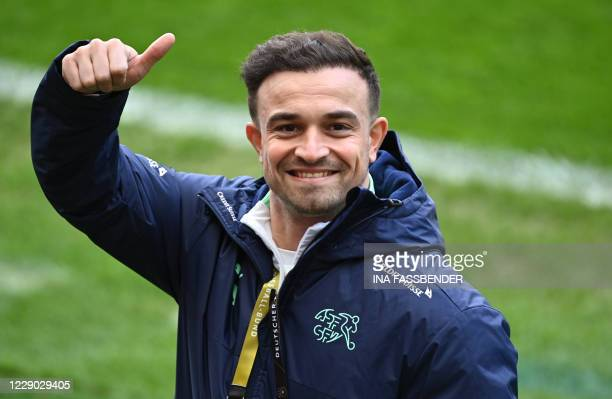 Switzerland's midfielder Xherdan Shaqiri gives the thumbs up before a training session on the eve of the UEFA Nations League football match Germany v...