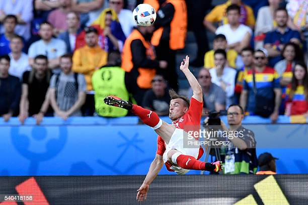 Switzerland's midfielder Xherdan Shaqiri in action during the Euro 2016 group A football match between Romania and Switzerland at the Parc des...