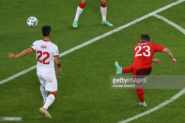 Switzerland's midfielder Xherdan Shaqiri scores his team's second goal during the UEFA EURO 2020 Group A football match between Switzerland and...