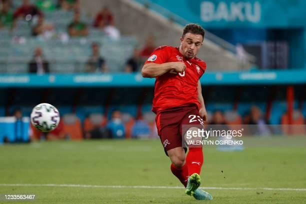 Switzerland's midfielder Xherdan Shaqiri scores his team's third goal during the UEFA EURO 2020 Group A football match between Switzerland and Turkey...
