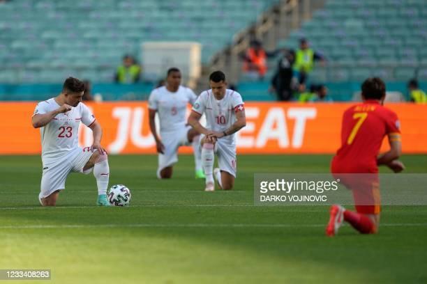 Switzerland's midfielder Xherdan Shaqiri, Switzerland's defender Manuel Akanji, Switzerland's midfielder Granit Xhaka and Wales' midfielder Joe Allen...