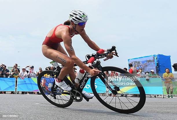 Switzerland's Nicola Spirig competes in the cycling portion of the women's triathlon at Fort Copacabana during the Rio 2016 Olympic Games in Rio de...
