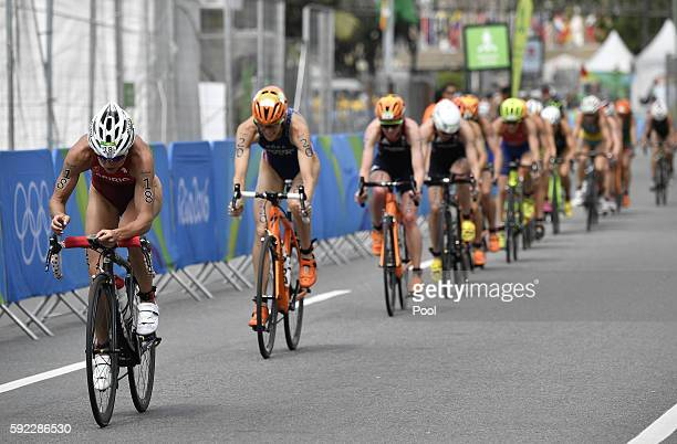 Switzerland's Nicola Spirig leads other athletes competing in the cycling portion of the women's triathlon at Fort Copacabana during the Rio 2016...
