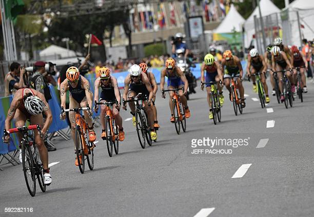 Switzerland's Nicola Spirig looks back at other athletes competing in the cycling portion of the women's triathlon at Fort Copacabana during the Rio...