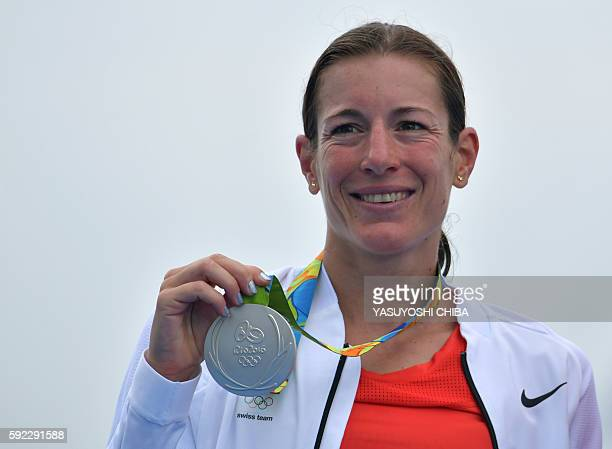 Switzerland's Nicola Spirig receives her silver medal on the podium after the women's triathlon at Fort Copacabana during the Rio 2016 Olympic Games...