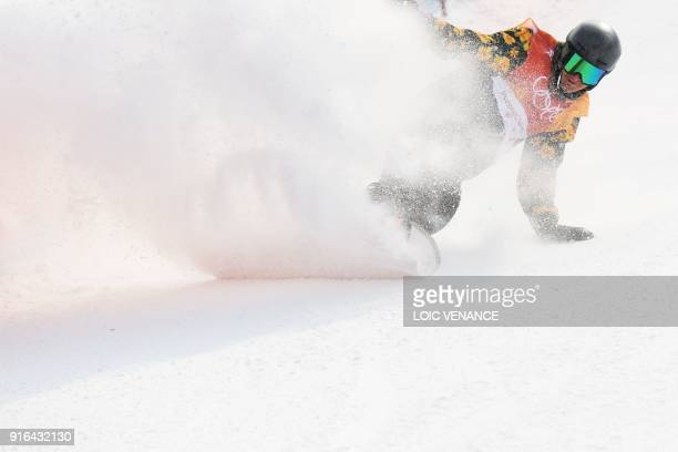 TOPSHOT Switzerland's Nicolas Huber finishes his round of qualification for the men's snowboard slopestyle at the Phoenix Park during the Pyeongchang...