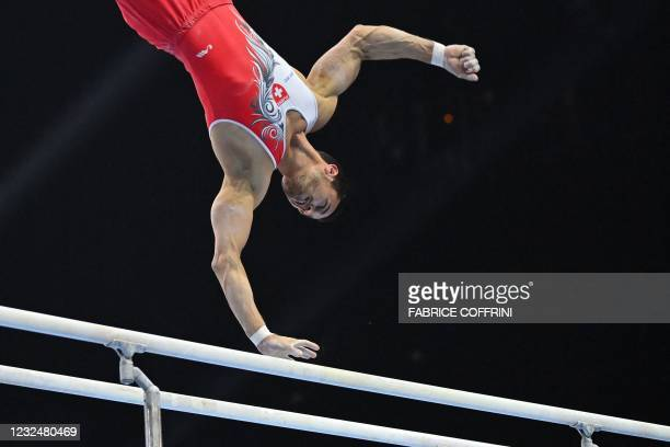 Switzerland's Pablo Braegger competes in the parallel bars competition during the Men's all-around final of the 2021 European Artistic Gymnastics...