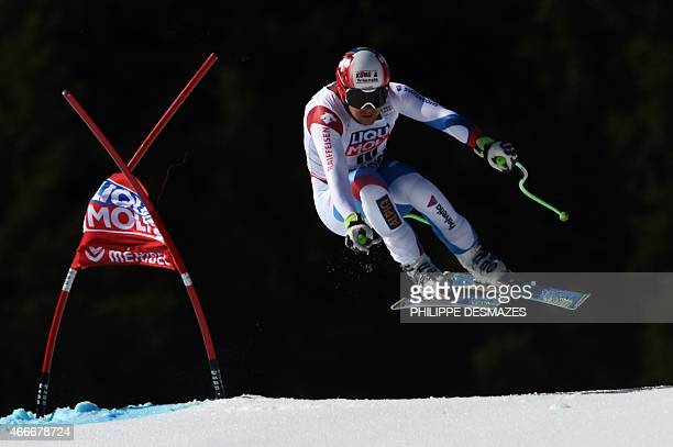 Switzerland's Patrick Kueng competes in the Men's downhill at the FIS Alpine Skiing World Cup finals in Meribel on March 18 2015 AFP PHOTO / PHILIPPE...