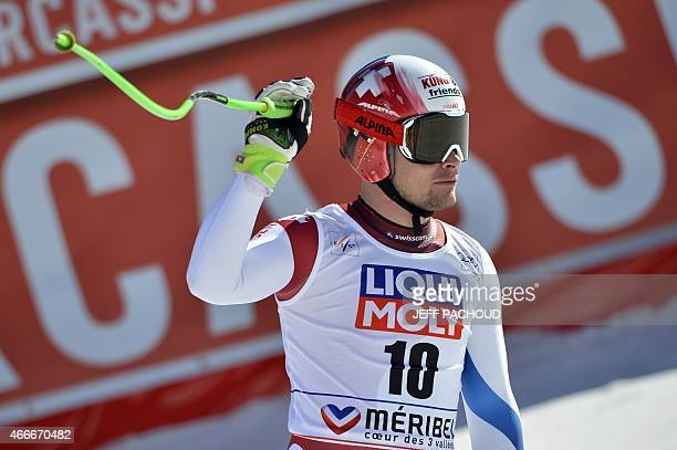 Switzerland's Patrick Kueng reacts after the Men's downhill at the FIS Alpine Skiing World Cup finals in Meribel on March 18 2015 AFP PHOTO / JEFF...