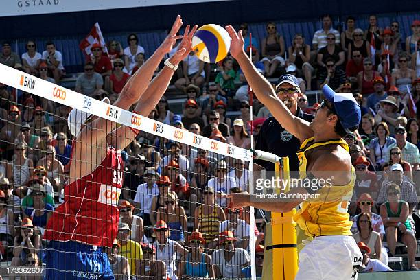 Switzerland's Philip Gabathuler defends as Italy's Daniele Lupo attacks during the NicolaiLupo v GabathulerWeingart game as part of the FIVB Gstaad...