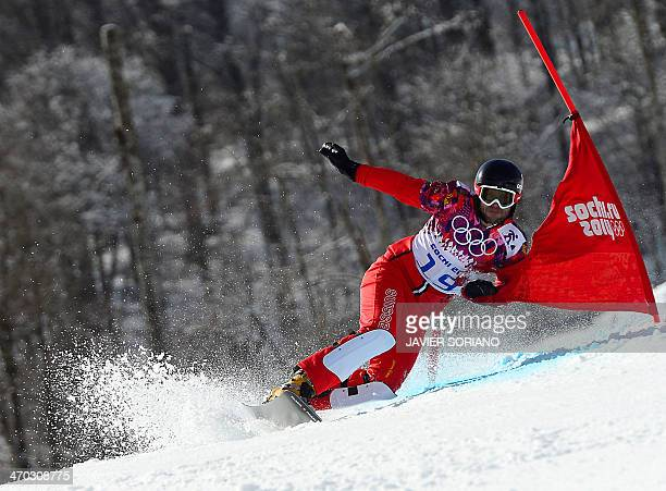 Switzerland's Philipp Schoch competes in the Men's Snowboard Parallel Giant Slalom 1/8 Finals at the Rosa Khutor Extreme Park during the Sochi Winter...