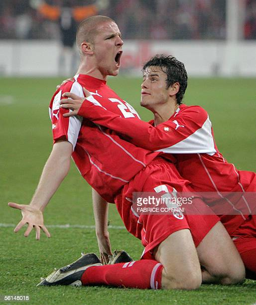 Switzerland's Philippe Sanderos reacts with teammate Tranquillo Barnetta after he scored the first goal during their WC2006 playoff first leg soccer...