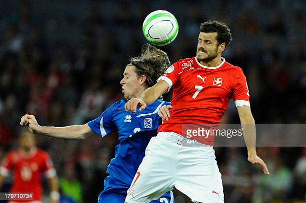 Switzerland's player Tranquillo Barnetta vies with Iceland's Bikir Saevarsson during the FIFA World Cup 2014 qualifying football match between...