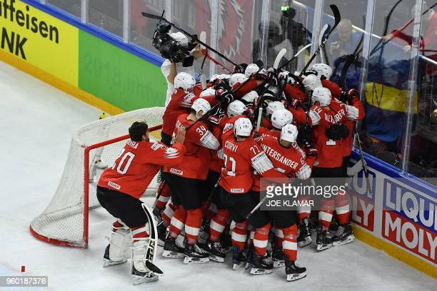 TOPSHOT Switzerland's players celebrate after the semifinal match Canada vs Switzerland of the 2018 IIHF Ice Hockey World Championship at the Royal...